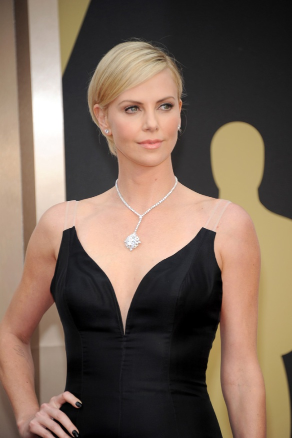 Charlize Theron wore a fitted black Valentino gown to the 2014 Academy Awards, perfectly framing the staggering US$15m Harry Winston diamond necklace.